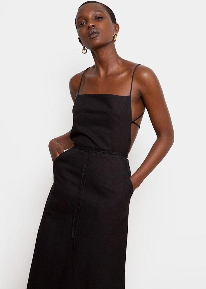 """Can you have too many LBDs? We're thinking not. <br> <br> <strong>The Frankie Shop</strong> Strap Back Apron Dress, $, available at <a href=""""https://go.skimresources.com/?id=30283X879131&url=https%3A%2F%2Fthefrankieshop.com%2Fcollections%2Fdresses-1%2Fproducts%2Fstrap-back-apron-dress-black"""" rel=""""nofollow noopener"""" target=""""_blank"""" data-ylk=""""slk:The Frankie Shop"""" class=""""link rapid-noclick-resp"""">The Frankie Shop</a>"""