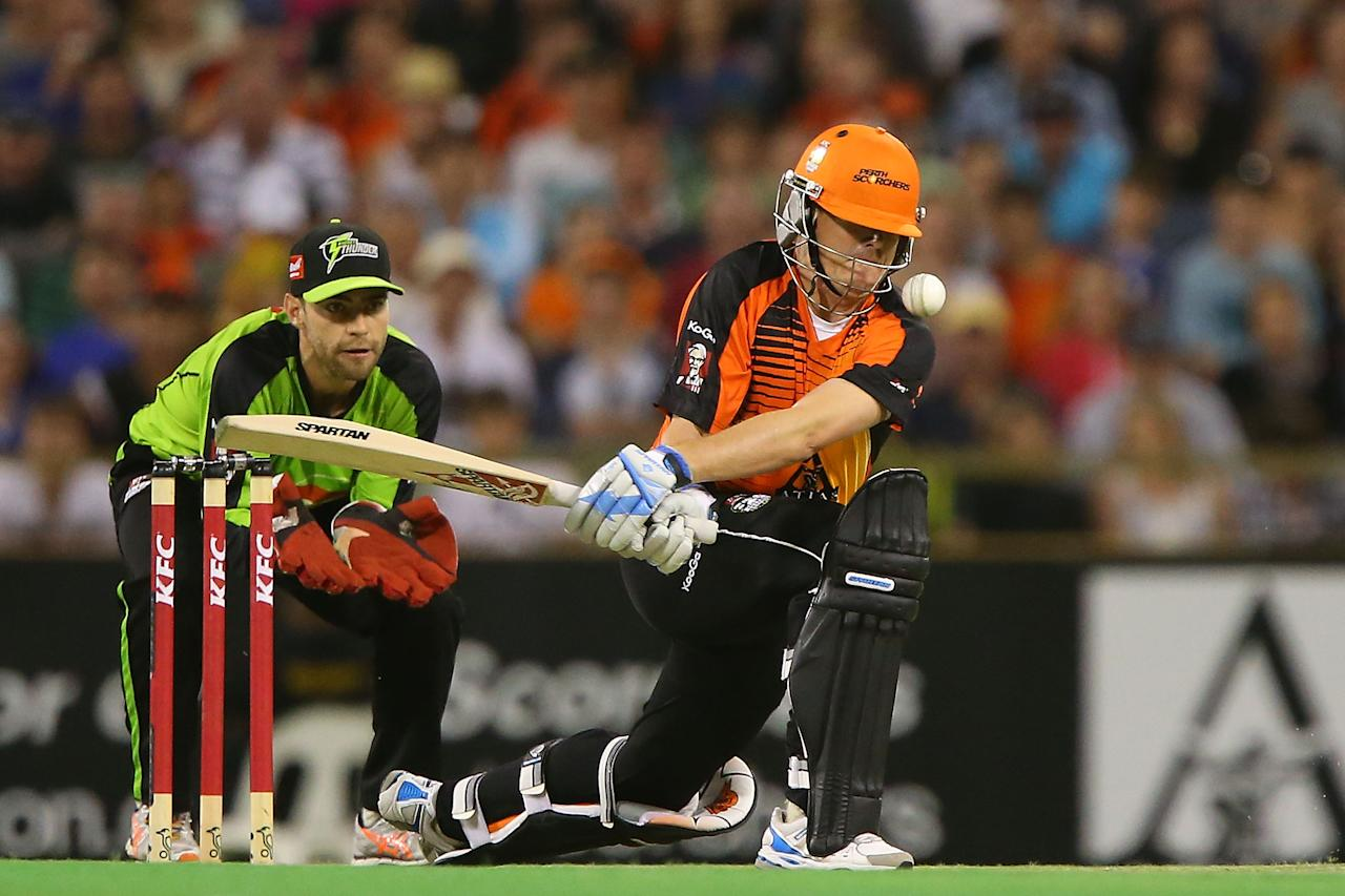 PERTH, AUSTRALIA - JANUARY 04:  Marcus North of the Scorchers attempts to sweep during the Big Bash League match between the Perth Scorchers and the Sydney Thunder at WACA on January 4, 2013 in Perth, Australia.  (Photo by Paul Kane/Getty Images)