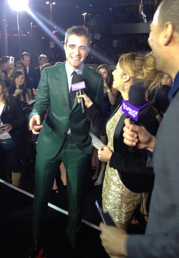 Robert Pattinson brings some colorful cheer to the black carpet!
