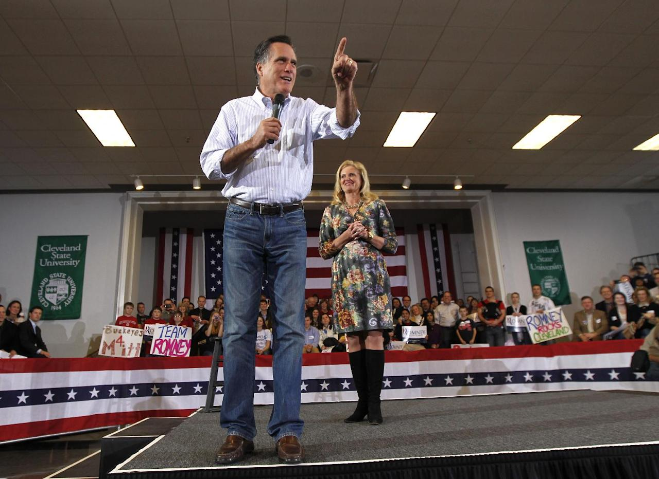 Republican presidential candidate, former Massachusetts Gov. Mitt Romney speaks with his wife, Ann, at a campaign rally in Cleveland, Friday, March 2, 2012. (AP Photo/Gerald Herbert)
