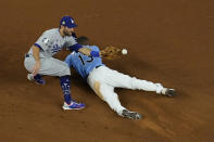 Tampa Bay Rays' Manuel Margot steals second past Los Angeles Dodgers second baseman Chris Taylor during the fourth inning in Game 5 of the baseball World Series Sunday, Oct. 25, 2020, in Arlington, Texas. (AP Photo/David J. Phillip)