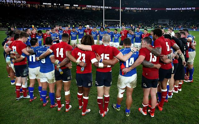 England and Samoa's players share a prayer after their match in 2014 - The RFU Collection
