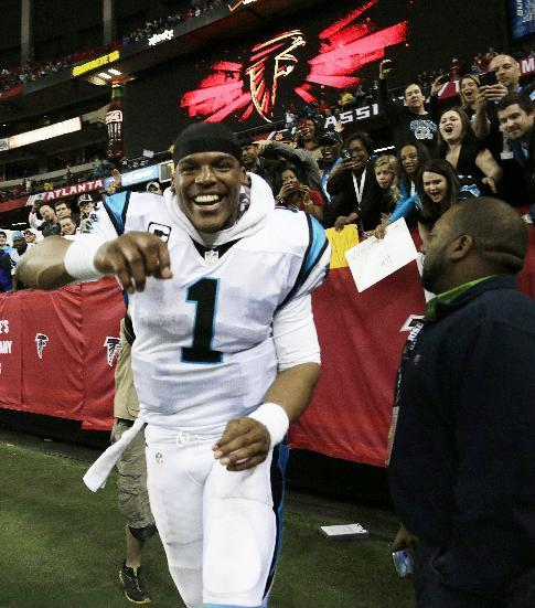 Carolina Panthers quarterback Cam Newton runs after the second half of an NFL football game against the Atlanta Falcons, Sunday, Dec. 29, 2013, in Atlanta. (AP Photo/Dave Martin)