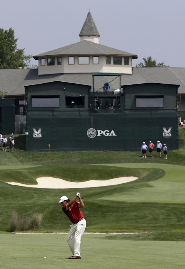 Phil Mickelson hits from the fairway on the 18th hole during a practice round for the PGA Championship golf tournament at Valhalla Golf Club on Tuesday, Aug. 5, 2014, in Louisville, Ky. The tournament is set to begin on Thursday. (AP Photo/David J. Phillip)