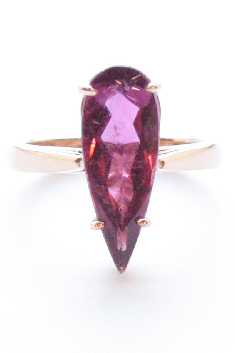 "<p>An elongated pear cut lengthens the look of your finger and keeps the eye drawn to the star of the ring, the unique ruby at the center.<br></p><p><em>""Pito Ring"" pear-shaped facetted rubellite in eighteen-karat rose gold, $7,400, <a href=""http://www.sharonkhazzam.com"" rel=""nofollow noopener"" target=""_blank"" data-ylk=""slk:sharonkhazzam.com"" class=""link rapid-noclick-resp"">sharonkhazzam.com</a>.</em></p><p><a class=""link rapid-noclick-resp"" href=""http://www.sharonkhazzam.com"" rel=""nofollow noopener"" target=""_blank"" data-ylk=""slk:SHOP"">SHOP</a></p>"