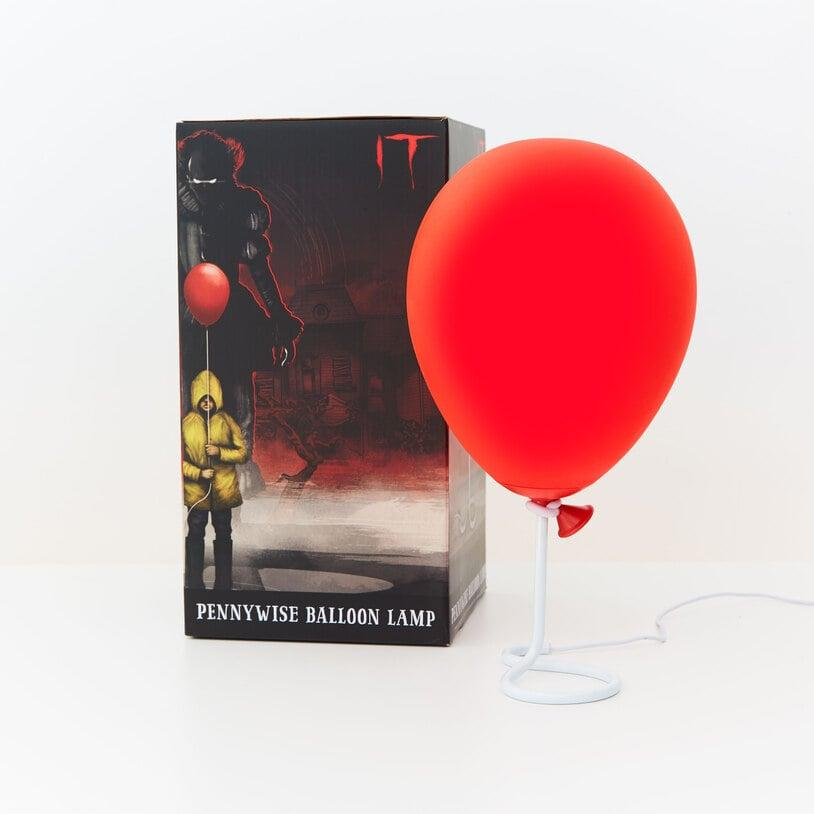 """<p>The <a href=""""https://www.popsugar.com/buy/Pennywise-Balloon-Lamp-487702?p_name=Pennywise%20Balloon%20Lamp&retailer=firebox.com&pid=487702&price=37&evar1=casa%3Aus&evar9=46578659&evar98=https%3A%2F%2Fwww.popsugar.com%2Fhome%2Fphoto-gallery%2F46578659%2Fimage%2F46578664%2FPennywise-Balloon-Lamp&list1=halloween%2Challoween%20decor%2Cit%20chapter%20two&prop13=api&pdata=1"""" rel=""""nofollow"""" data-shoppable-link=""""1"""" target=""""_blank"""" class=""""_e75a791d-denali-editor-page-rtfLink ga-track"""" data-ga-category=""""Related"""" data-ga-label=""""http://www.firebox.com/Pennywise-Balloon-Lamp/p9188?aff=512&amp;awc=550_1567639916_c800e6f8a662af9eda1ca83809e5fbd9&amp;utm_source=AffiliateWindow&amp;utm_medium=Affiliates&amp;utm_content=Skimlinks&amp;utm_campaign=Skimlinks&amp;ref=popsugar.com"""" data-ga-action=""""In-Line Links"""">Pennywise Balloon Lamp</a> ($37) is officially licensed <strong>It</strong> merchandise, and the neatly illustrated box makes it the perfect gift for fans of the movie.</p>"""