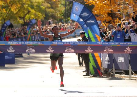 Athletics - New York City Marathon - New York City, New York, U.S. - November 4, 2018  Ethiopia's Lelisa Desisa crosses the finish line to win the Professional Men's race  REUTERS/Brendan McDermid