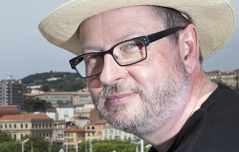 "FILE - In this May 18, 2011 file photo, director Lars Von Trier poses for portraits after an interview promoting the film ""Melancholia"" at the 64th international film festival, in Cannes, southern France.  Von Trier is taking back his apology for saying at the Cannes Film Festival he sympathizes with Adolf Hitler.  Earlier this year at Cannes, the Danish filmmaker said he had believed he was Jewish until his mother told him on her deathbed that he wasn't. He said his German ancestry made him ""sympathize with (Hitler) a little bit."" He added that he supports Jews.  (AP Photo/Joel Ryan, file)"