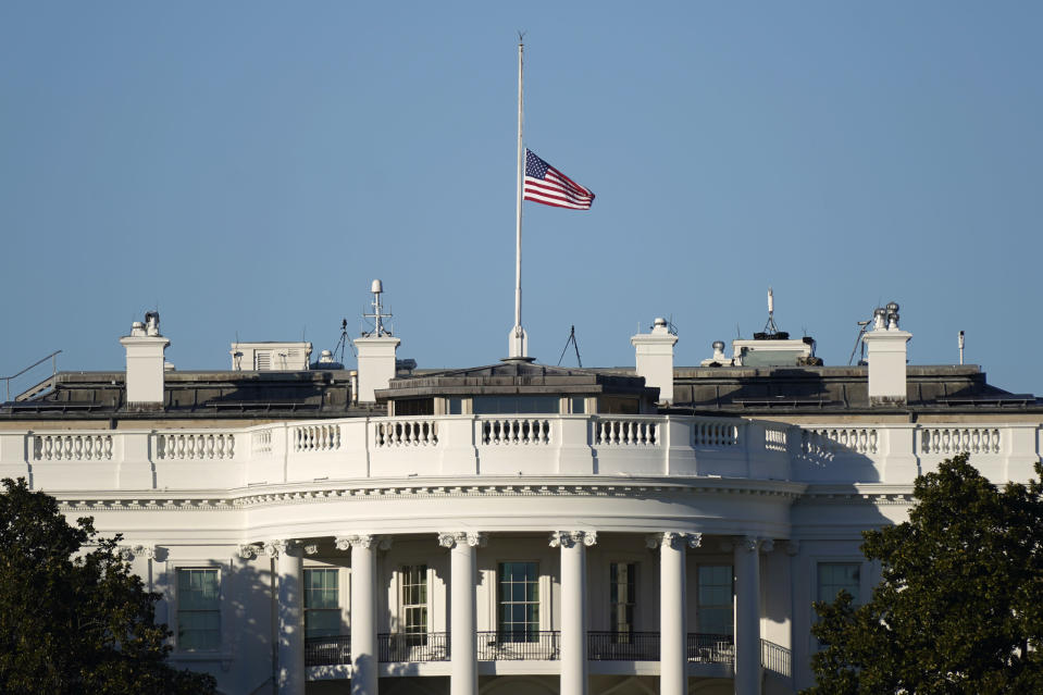 An American flag flies at half-staff above the White House in Washington, Sunday, Jan. 10, 2021. (AP Photo/Patrick Semansky)