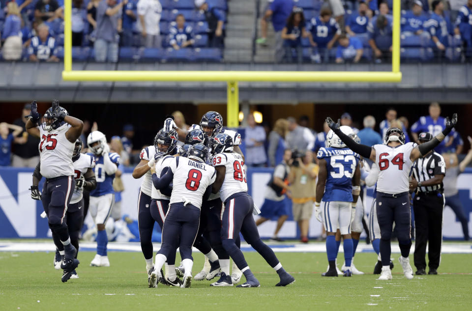 Houston Texans kicker Ka'imi Fairbairn (7) celebrates with teammates after kicking the game winning field goal during overtime of an NFL football game against the Indianapolis Colts, Sunday, Sept. 30, 2018, in Indianapolis. Houston won 37-34. (AP Photo/Darron Cummings)