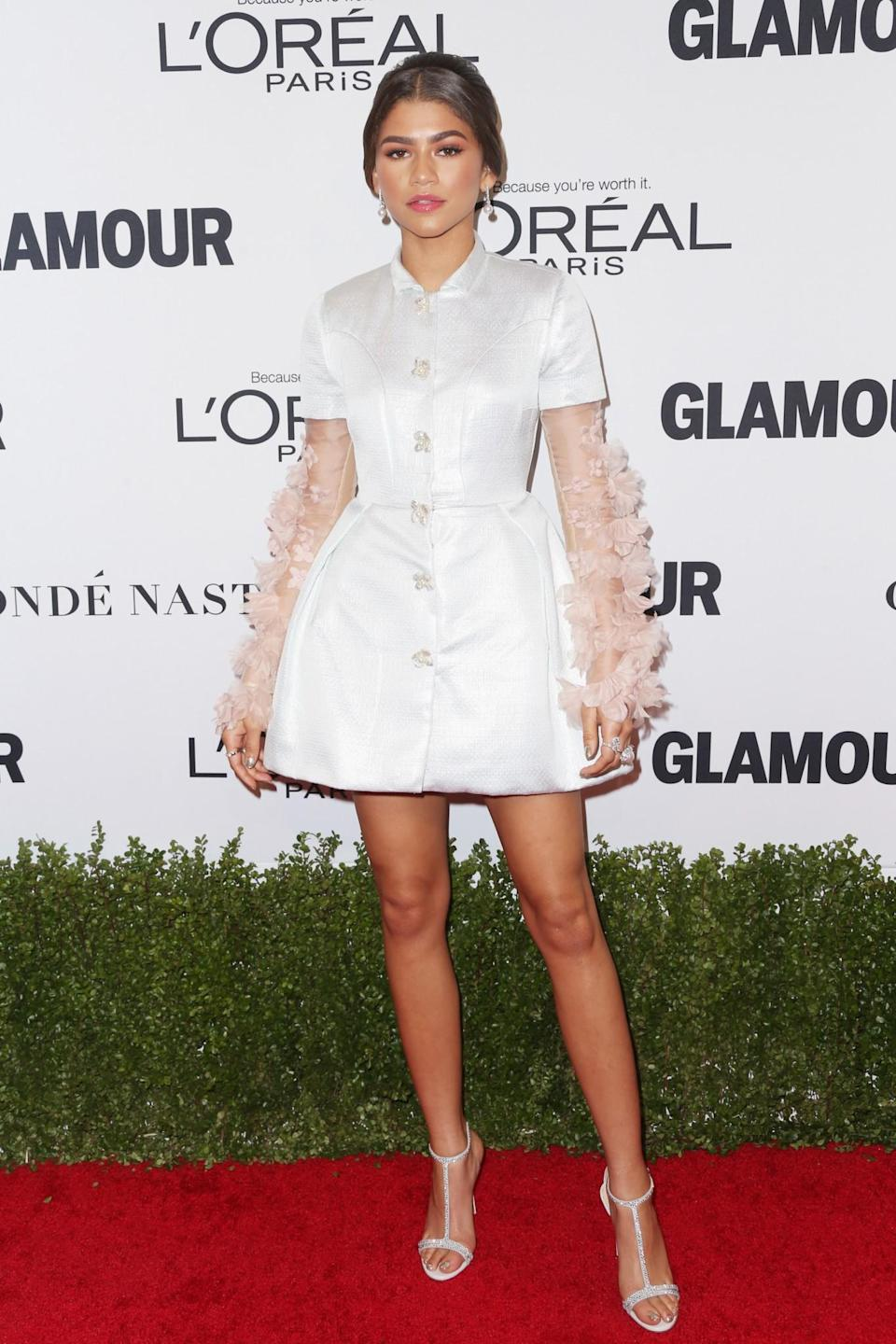 <p>Zendaya's cream Reem Acra dress with interesting ruffled sleeves added yet another style win to her impressive roster. <i>[Photo: Getty]</i> </p>