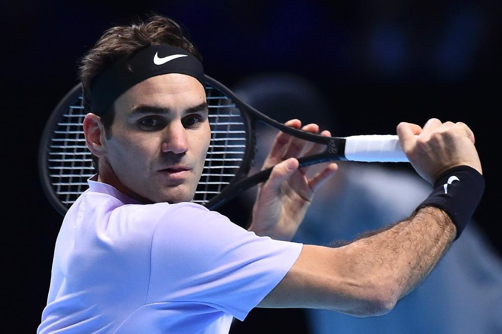 Roger Federer returned from six months out with knee trouble to win the Australian Open before picking up a record eighth Wimbledon crown (AFP Photo/Glyn KIRK                  )