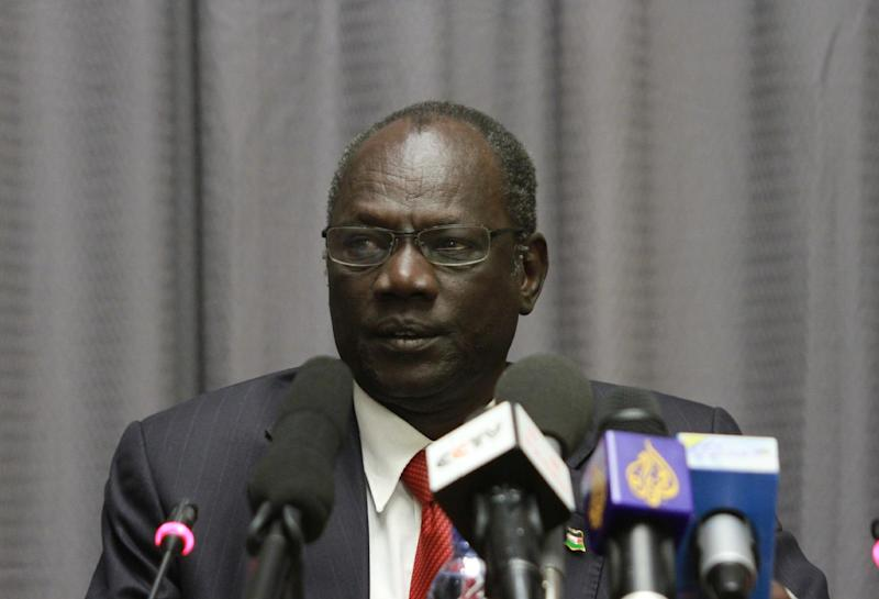 "South Sudanese information minister, Michael Makuei Lueth attends a press conference in Addis Ababa, Ethiopia, Sunday Jan. 5, 2014. Lueth threatened to apprehend Rebecca Nyandeng de Mabior, the widow of former SPLM, the late John Garang, as she is spreading ""negative propaganda."" (AP Photo/Elias Asmare)"