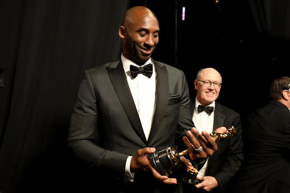 """Kobe Bryant won an Academy Award for best animated short for writing and directing an adaptation of his Players' Tribune essay, """"Dear Basketball,"""" a love letter to the game he wrote while coming to grips with his decision to retire in 2016. (Matt Sayles/A.M.P.A.S via Getty Images)"""