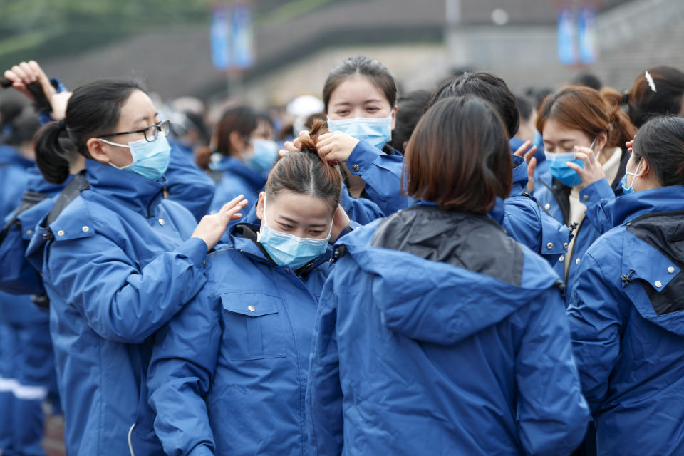 (200211) -- CHONGQING, Feb. 11, 2020 (Xinhua) -- Medical team members from Chongqing are seen at the gathering spot in southwest China's Chongqing, Feb. 11, 2020. A team comprised of 159 medical workers from Chongqing left for Xiaogan City of Hubei Province on Tuesday to aid the novel coronavirus control efforts there. They will work together with the first batch of medical workers who were dispatched there on Jan. 26. (Photo by Huang Wei/Xinhua) (Xinhua/Huang Wei via Getty Images)