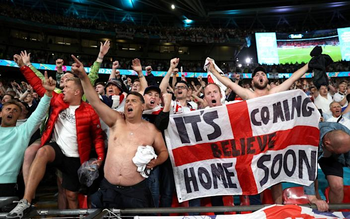 England fans celebrate at the Euro 2020 semi-final match against Denmark at Wembley Stadium on 7 July 2021 - Carl Recine/Pool via Reuters