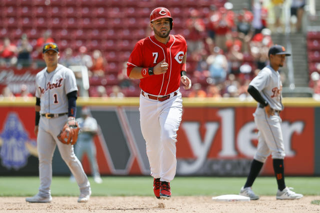 Cincinnati Reds' Eugenio Suarez runs the bases after hitting a solo home run off Detroit Tigers starting pitcher Michael Fulmer in the sixth inning of a baseball game, Wednesday, June 20, 2018, in Cincinnati. (AP Photo/John Minchillo)