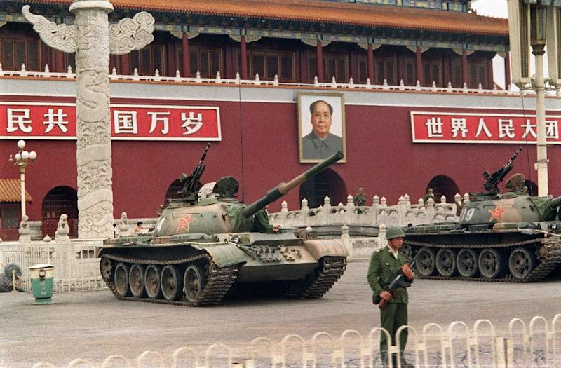 People's Liberation Army tanks guard Tiananmen Square in June 1989 after the bloody crackdown on pro-democracy protests (AFP Photo/CATHERINE HENRIETTE)