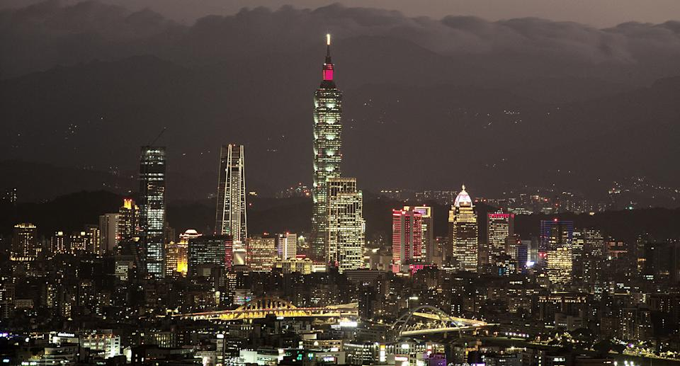 Fifty-six Chinese warplanes crossed into Taiwan's defence zone on Monday. A stock photo of Taipei's skyline at night is pictured.