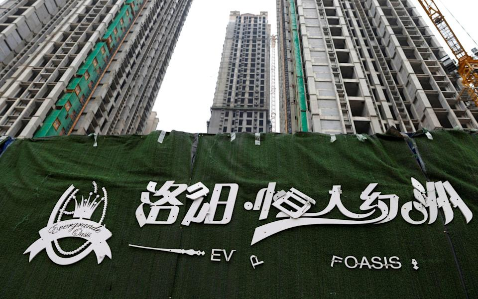 A peeling logo of the Evergrande Oasis, a housing complex developed by Evergrande Group - CARLOS GARCIA RAWLINS/REUTERS