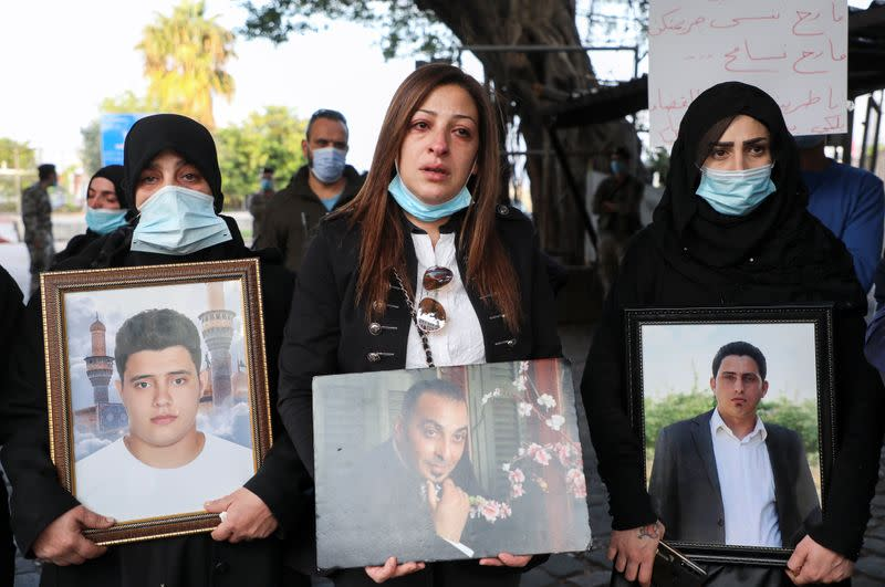 Samia Doughan holds a picture of her husband Mohammad, 48, who was killed in the explosion at the Port of Beirut