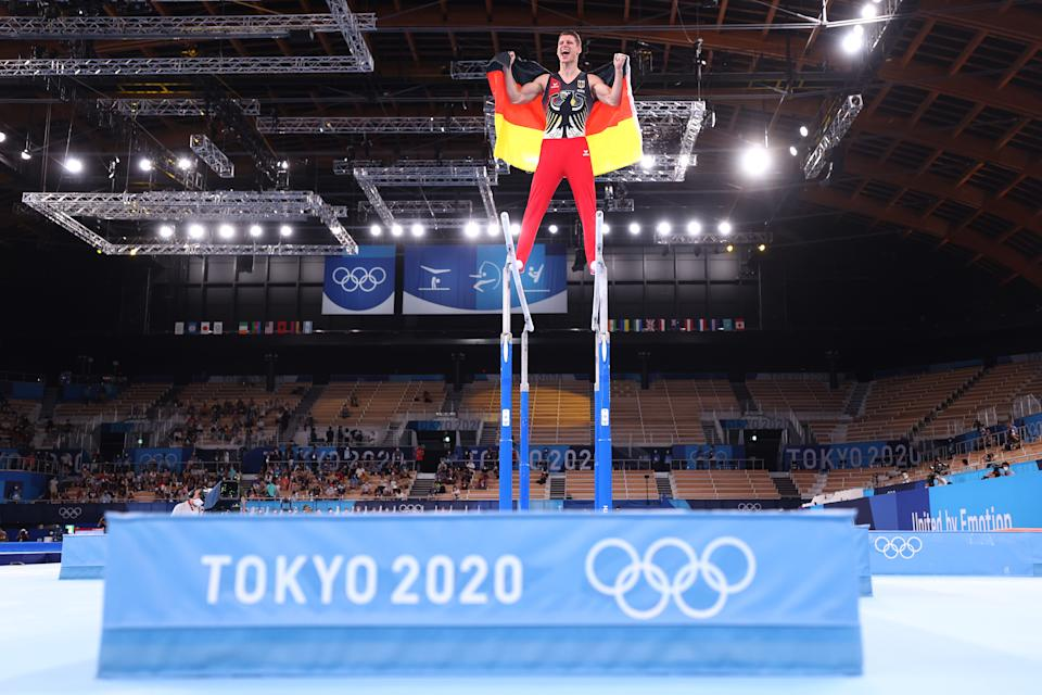 <p>TOKYO, JAPAN - AUGUST 03: Lukas Dauser of Team Germany celebrates winning silver during the Men's Parallel Bars Final on day eleven of the Tokyo 2020 Olympic Games at Ariake Gymnastics Centre on August 03, 2021 in Tokyo, Japan. (Photo by Jamie Squire/Getty Images)</p>