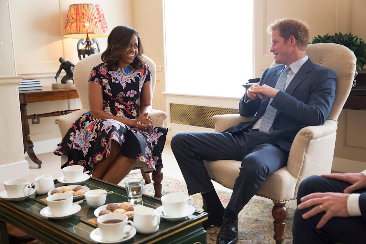 LONDON, ENGLAND - JUNE 16: In this handout photo provided by The White House, US First Lady Michelle Obama meets Prince Harry at Kensington Palace on June 16, 2015 in London, England. The US First Lady is travelling with her daughters, Malia and Sasha and her mother, Mrs. Marian Robinson, to continue a global tour promoting her 'Let Girls Learn Initiative'. The event at the school was to discuss how the UK and USA are working together to expand girl's education around the world. (Photo by Amanda Lucidon/The White House via Getty Images)