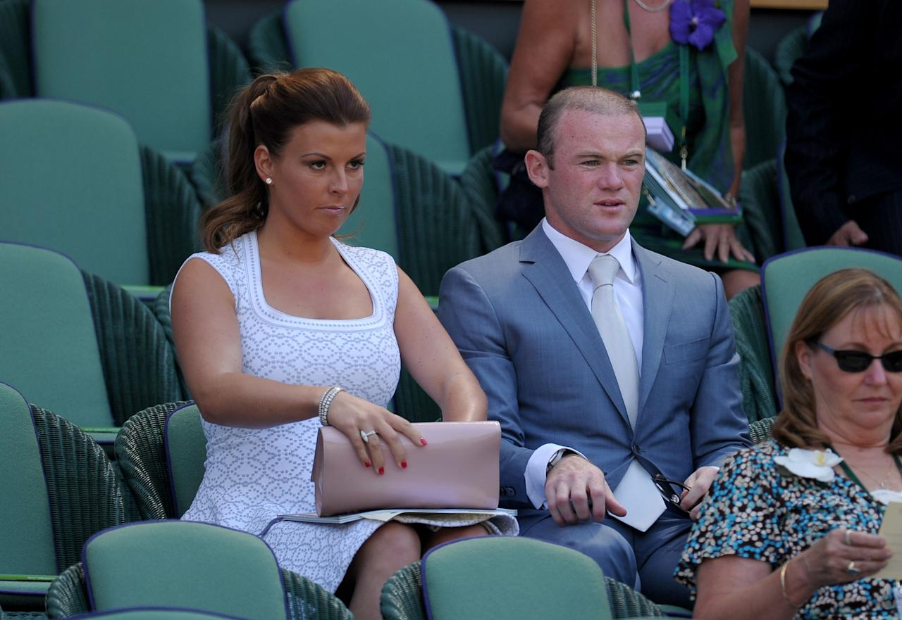 Wayne and Coleen Rooney in the Royal Box on Centre Court during day thirteen of the Wimbledon Championships at The All England Lawn Tennis and Croquet Club, Wimbledon.