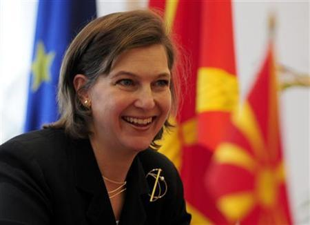 U.S. ambassador to NATO Nuland gestures during a meeting with Macedonia's Prime Minister Gruevski in Skopje