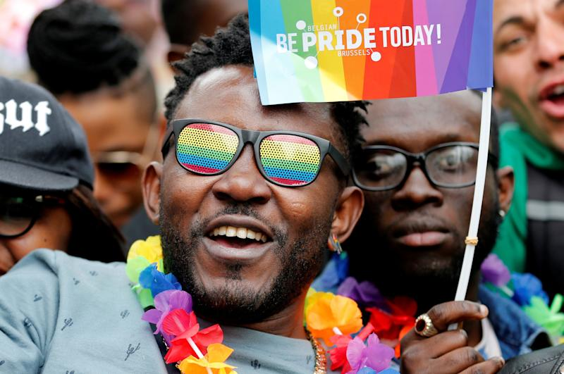 Participants watch the annual Belgian LGBTQ Pride Parade in central Brussels, Belgium, May 19, 2018.