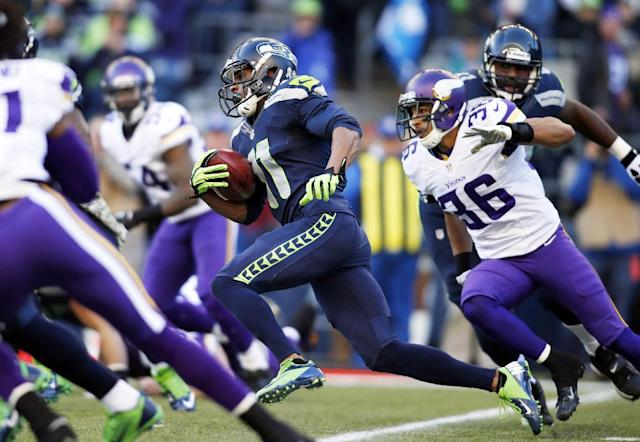 Seattle Seahawks' Percy Harvin (11) returns the ball against the Minnesota Vikings on a kick off in the first half of an NFL football game Sunday, Nov. 17, 2013, in Seattle. (AP Photo/John Froschauer)
