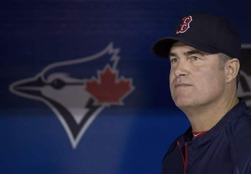 Boston Red Sox manager John Farrell look on from the dugout before playing against the Toronto Blue Jays in a baseball game in Toronto, Friday, April 5, 2013. (AP Photo/The Canadian Press, Nathan Denette)