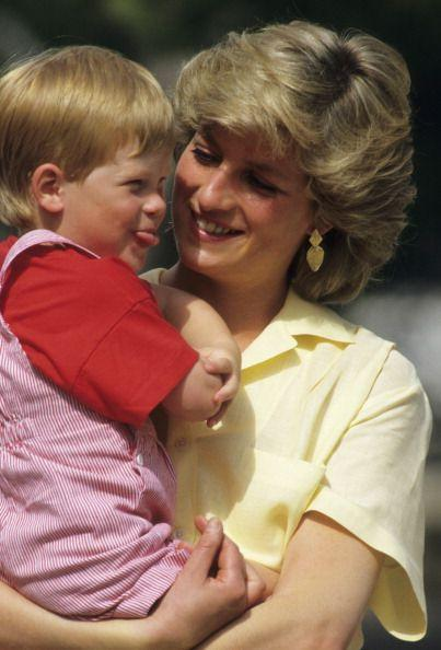 <p>Diana and a rascally Prince Harry share a smile while on vacation in Spain in 1987.</p>