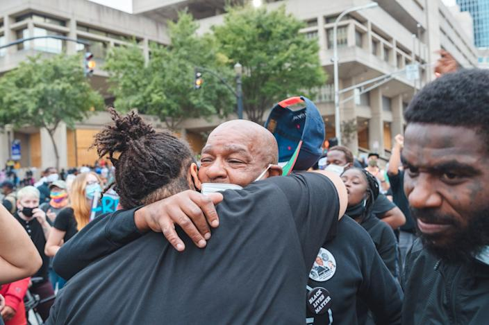 """Two protesters embrace near Jefferson Square Park on September 23, 2020 in Louisville, Kentucky. <p class=""""copyright"""">Jon Cherry/Getty Images</p>"""