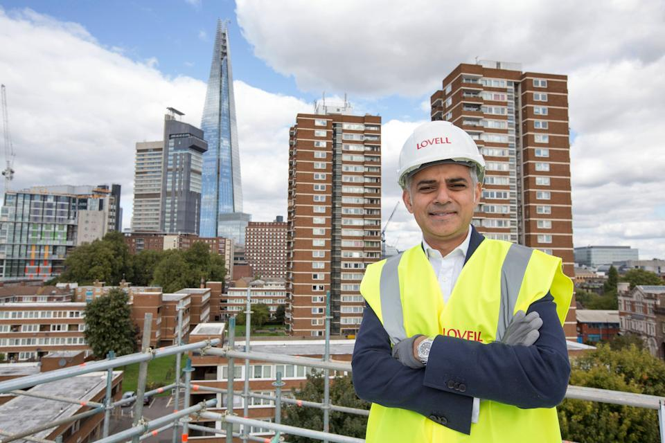 <p>Unfinished business: Sadiq Khan on the site of a development in Southwark earlier on in his mayoralty</p> (Alex Lentati)