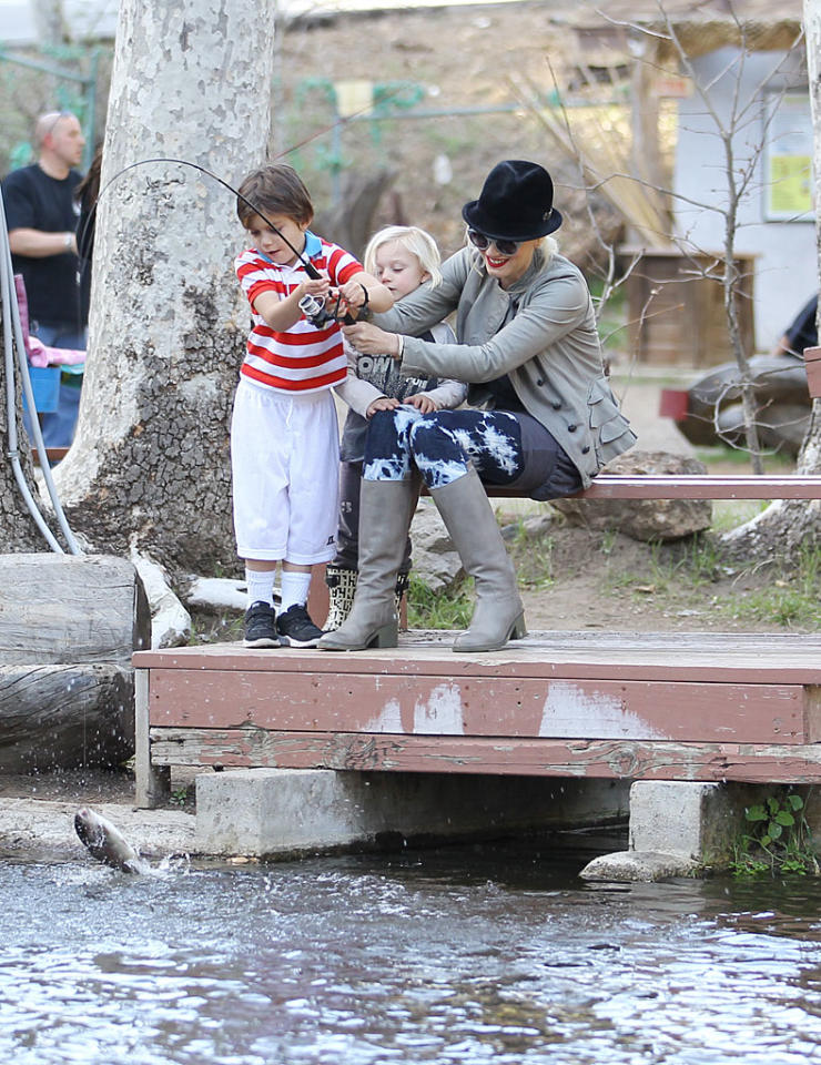 What a catch! Gwen Stefani helped her oldest son Kingston reel in a fish during a day at Troutdale Pond in Agoura Hills, California. (1/29/2012)