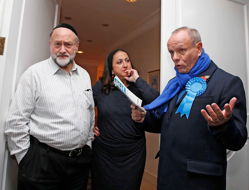 Mike Freer out campaigning in Golders Green, chatting with Danny and Alisa Feiner (NIGEL HOWARD ©)