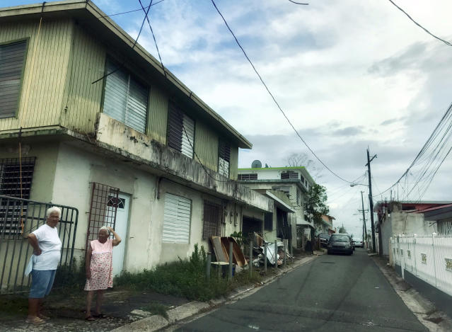 <p>Two women stand on a residential street in Bayamon, Puerto Rico on Oct. 7, 2017. Nearly three weeks after Hurricane Maria struck the island, Bayamon residents were still without power or electricity. (Photo: Caitlin Dickson/Yahoo News) </p>