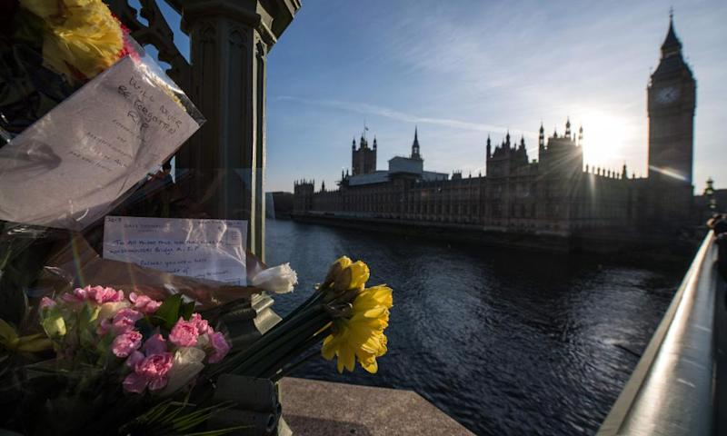 Floral tributes with Houses of Parliament in background
