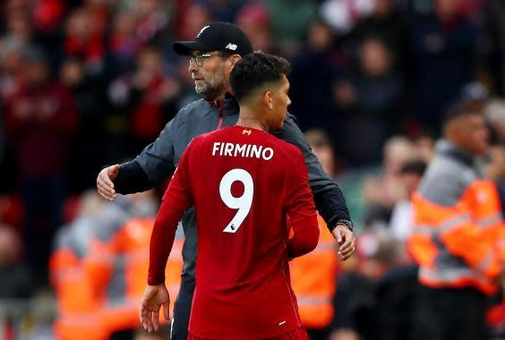 Firmino and Klopp embrace for Liverpool (Getty Images)