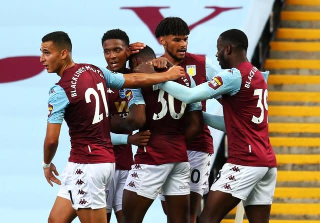 Villa's Kortney Hause, number 30, is congratulated by his team-mates after opening the scoring (PA)