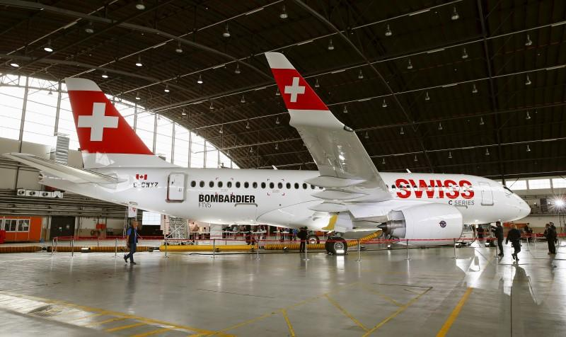 A new Bombardier CS100 passenger jet of Swiss airline stands in a hangar during a media presentation at Zurich airport near the town of Kloten