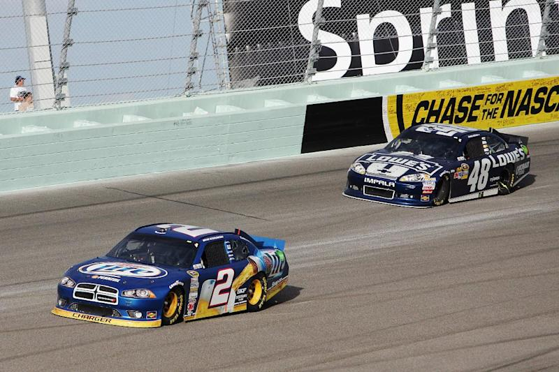Brad Keselowski (2) and Jimmie Johnson (48) compete during the NASCAR Sprint Cup Series auto race at Homestead-Miami Speedway, Sunday, Nov. 18, 2012, in Homestead, Fla. (AP Photo/The Miami Herald, Andrew Uloza) MAGS OUT