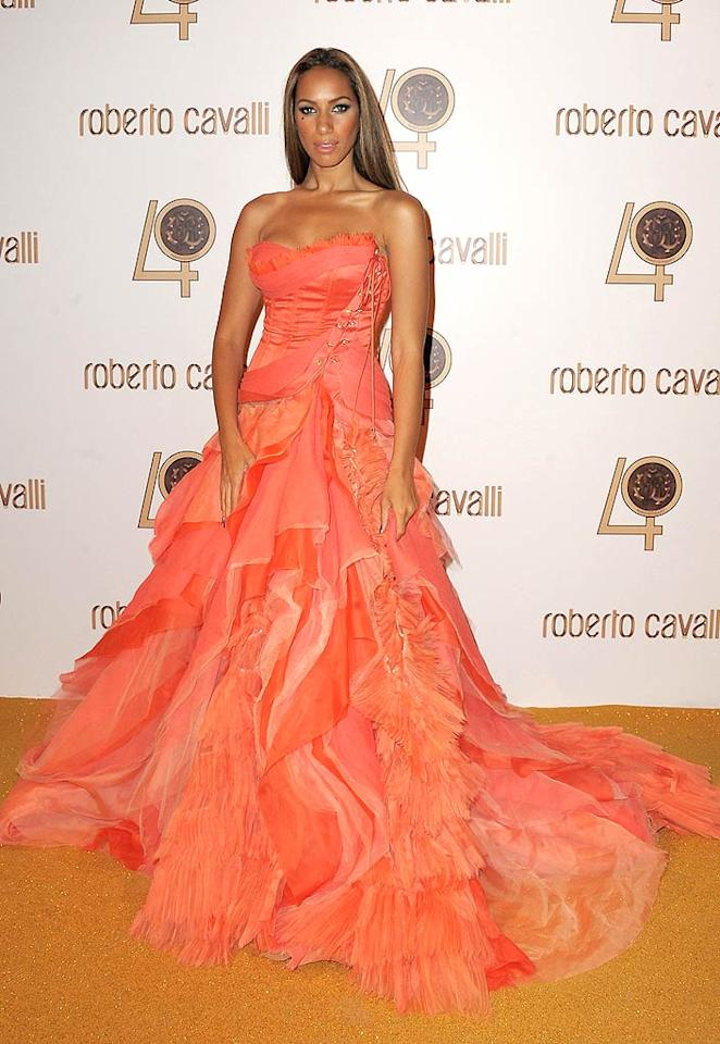 """Also letting her hair down? """"Happy"""" diva Leona Lewis, who donned an extravagant tangerine gown with a billowy skirt, injected with some added glam via her intricate bodice. Dominique Charriau/<a href=""""http://www.wireimage.com"""" target=""""new"""">WireImage.com</a> - September 29, 2010"""