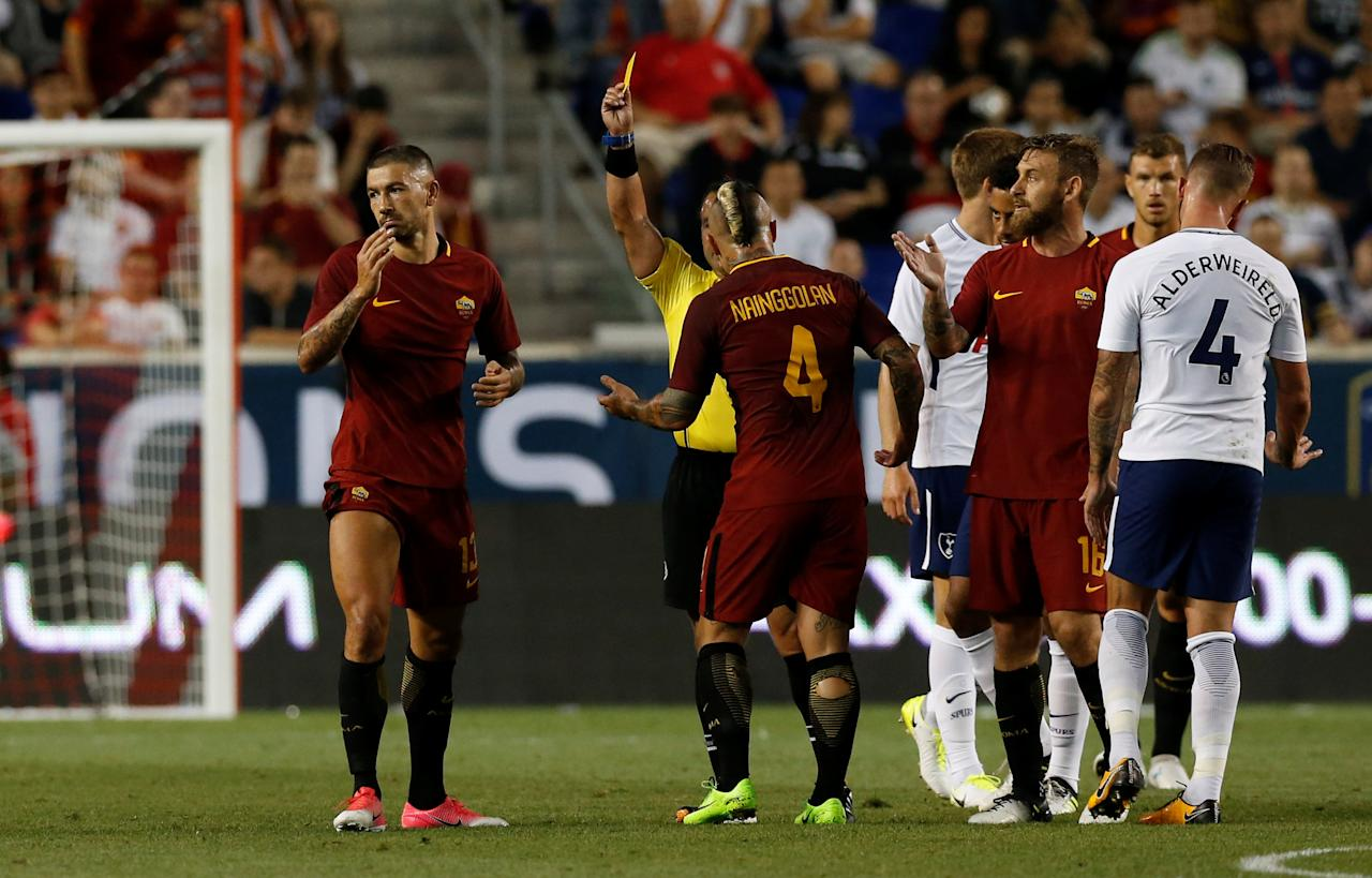 Soccer Football - AS Roma vs Tottenham Hotspur - International Champions Cup - Red Bull Arena, New Jersey - July 25, 2017   Roma's Aleksandar Kolarov is shown a yellow card by referee Hilario Grajeda   REUTERS/Mike Segar