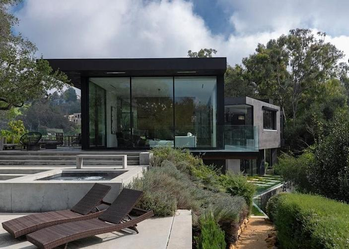 Exterior daytime shot of film producer Ken Kao's sleek, glass-heavy Beverly Hills mansion.