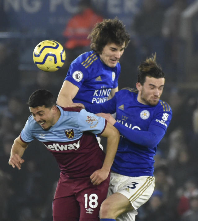 West Ham's Pablo Fornals, left, Leicester's Caglar Soyuncu and Leicester's Ben Chilwell, right, challenge for the ball during the English Premier League soccer match between Leicester City and West Ham Utd at the King Power Stadium in Leicester, England, Wednesday, Jan. 22, 2020. (AP Photo/Rui Vieira)