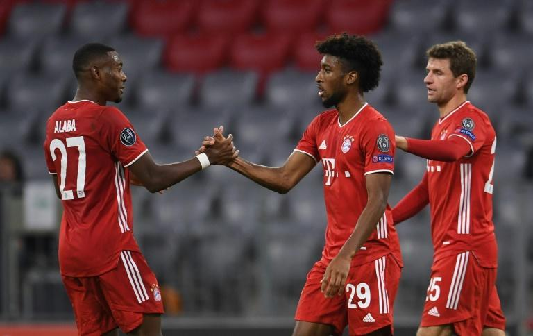 Kingsley Coman (C) celebrates scoring the opening goal in Bayern Munich's 2-0 win over Atletico Madrid