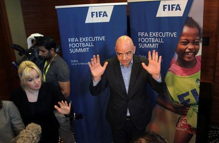 FIFA President Gianni Infantino gestures to the media in Doha, Qatar February 16, 2017. REUTERS/Naseem Zeitoon