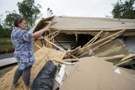 Vickie Savell gestures whole looking at the remains of her new mobile home early Monday, May 3, 2021, in Yazoo County, Miss. Multiple tornadoes were reported across Mississippi on Sunday, causing some damage but no immediate word of injuries. (AP Photo/Rogelio V. Solis)